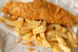 Traditional fish and chips in paper.